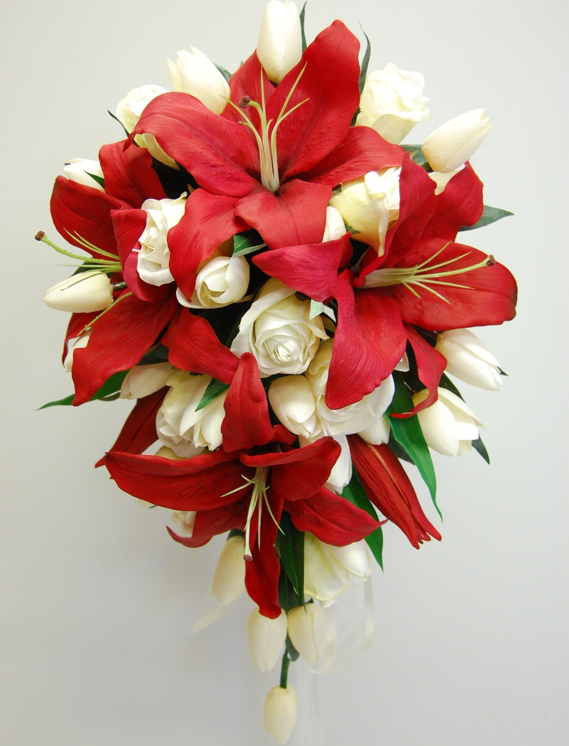 Red oriental lilies white roses and tulips teardrop wedding bouquet red oriental lilies white roses and tulips teardrop wedding bouquet izmirmasajfo