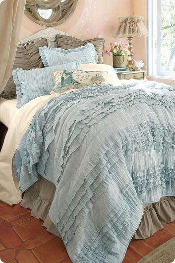 Lush texture and a soft handed cotton in a serene muted palette of pale blue, natural or ivory creates a casually elegant quilt, perfect for your own personal retreat. The waterfall of casual pleating becomes a soft feature for this lavish cotton-filled quilt.