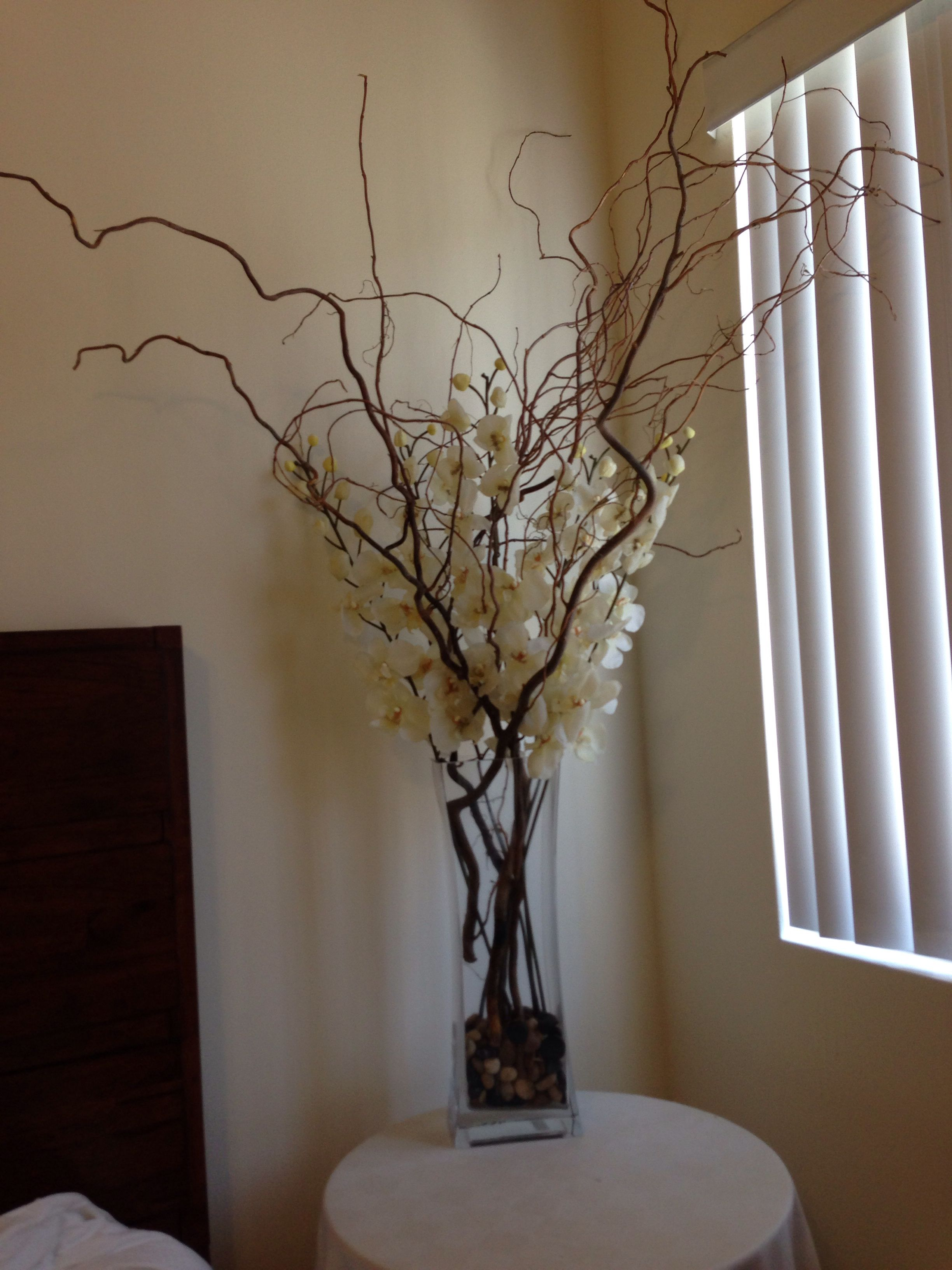 Silk Ivory Orchids With Large Branches In A Tall Rectangular Vase With Filler Stones This