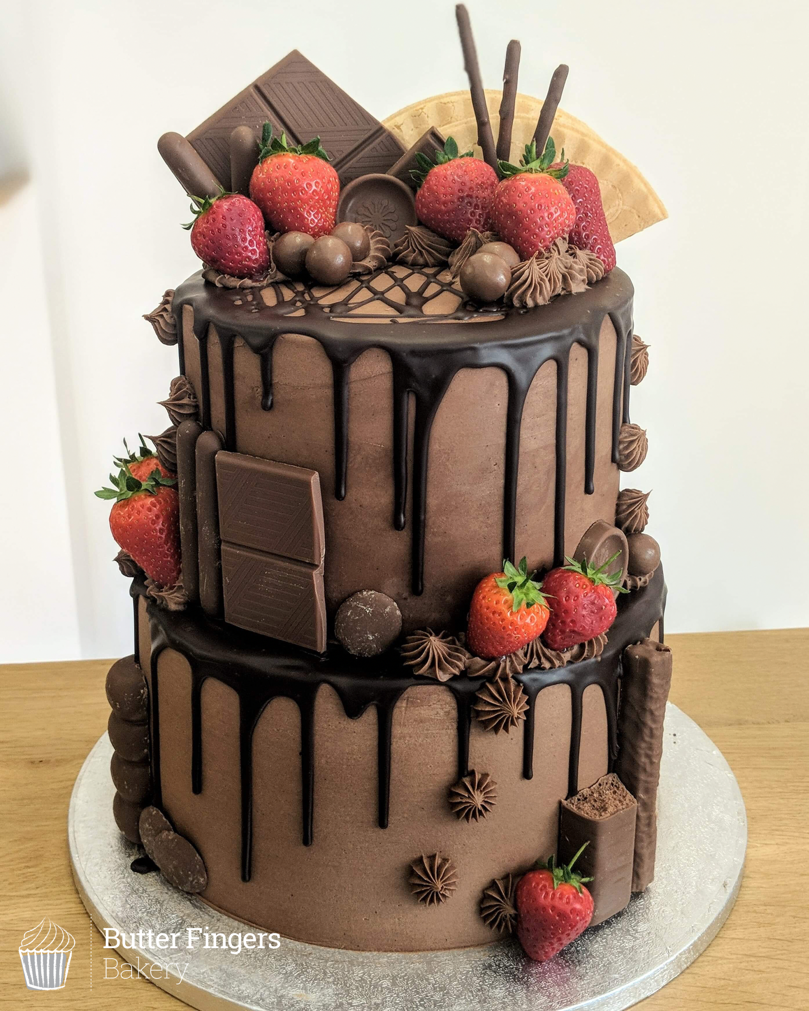 A Two Tier Chocolate Overload Drip Cake Decorated With Strawberries Birthday Birthdaycake Chocolat Strawberry Cakes Homemade Cakes Chocolate Cake Decoration