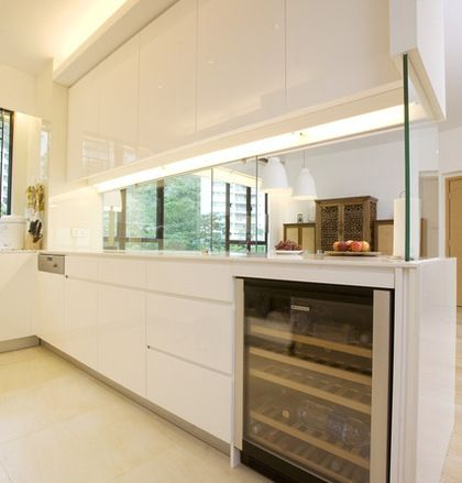 The sliding glass partition between the kitchen and the dining
