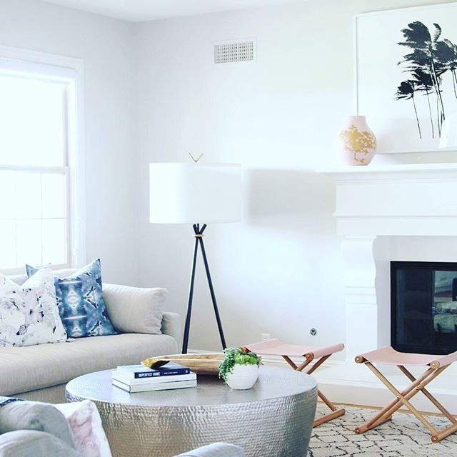 Kick your feet up and enjoy the ease and breeze of this beautiful living room design by @beckiowens featuring #MintedArt by Simone Klein. Shop the look via the link in profile.