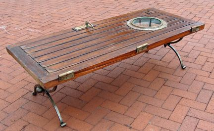 coffee table made using a teak ship's door and blacksmith made