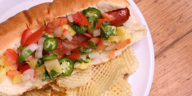 Salty, hot, and sweet, this Mexican Hotdog with Pineapple Pico de Gallo recipe will become your go-to for summer bbqs. Topped with a new twist on a classic recipe, this hot dog is worth going