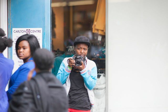 IDAHOT 2013, Johannesburg. Collen Mfazwe of Inkanyiso.Org  taking pictures of people watching the flashmob.