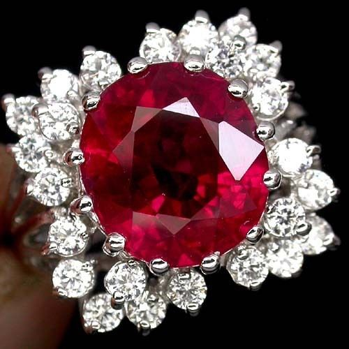 RUBY 5.70ctw  White sapphires in Sterling silver ring ruby 12 x 10.6mm. ROUND DIAMOND CUT WHITE SAPPHIRES 2.3 MM. 24 PCS.  FACE 1.8 X 1.7 CM.  Stones from Madagascar & Africa