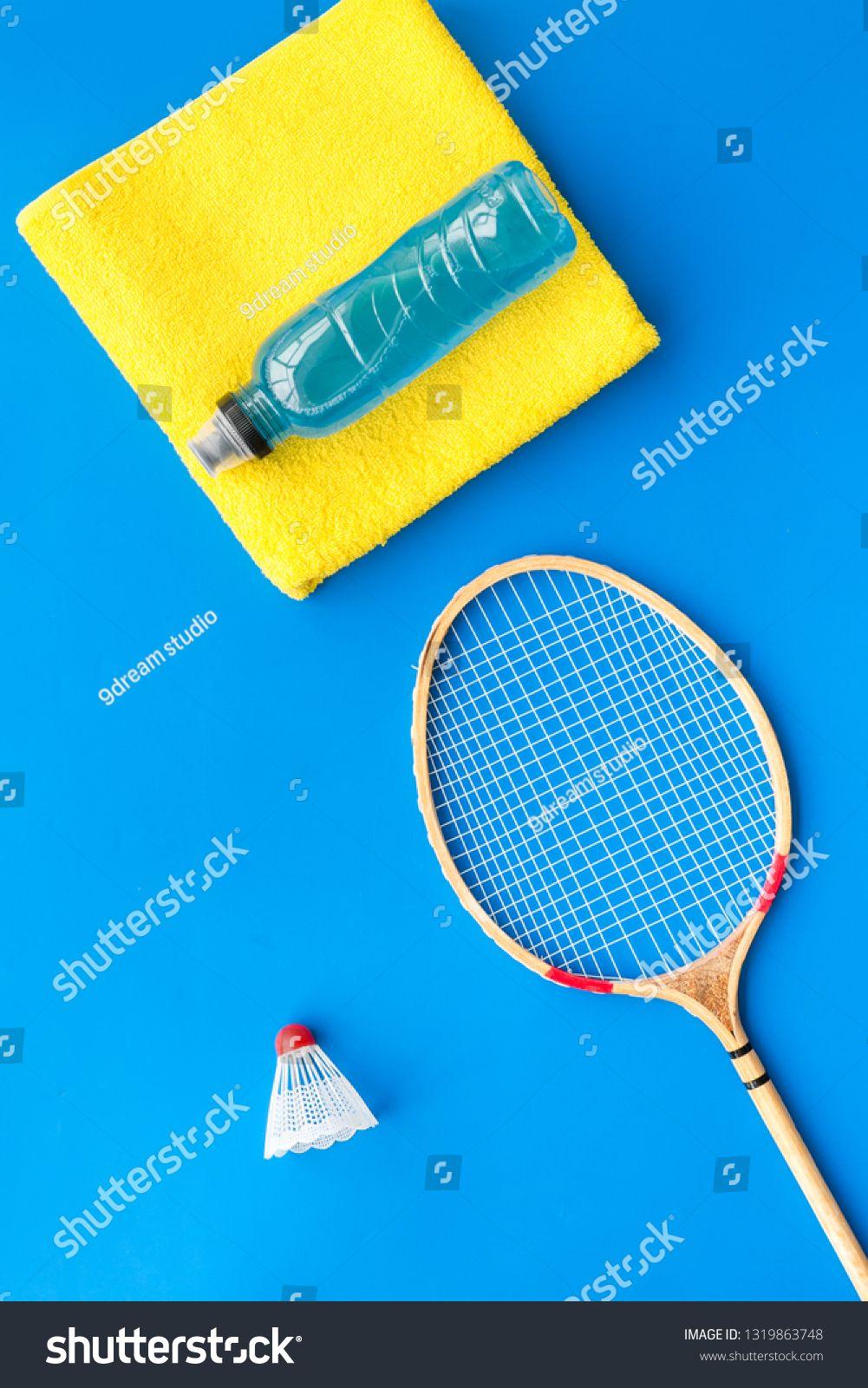 Badminton Training Concept Badminton Racket Shuttlecock Sport Drink And Towel On Blue Background Top View Copy Space Shuttlecocks Badminton Racket Badminton