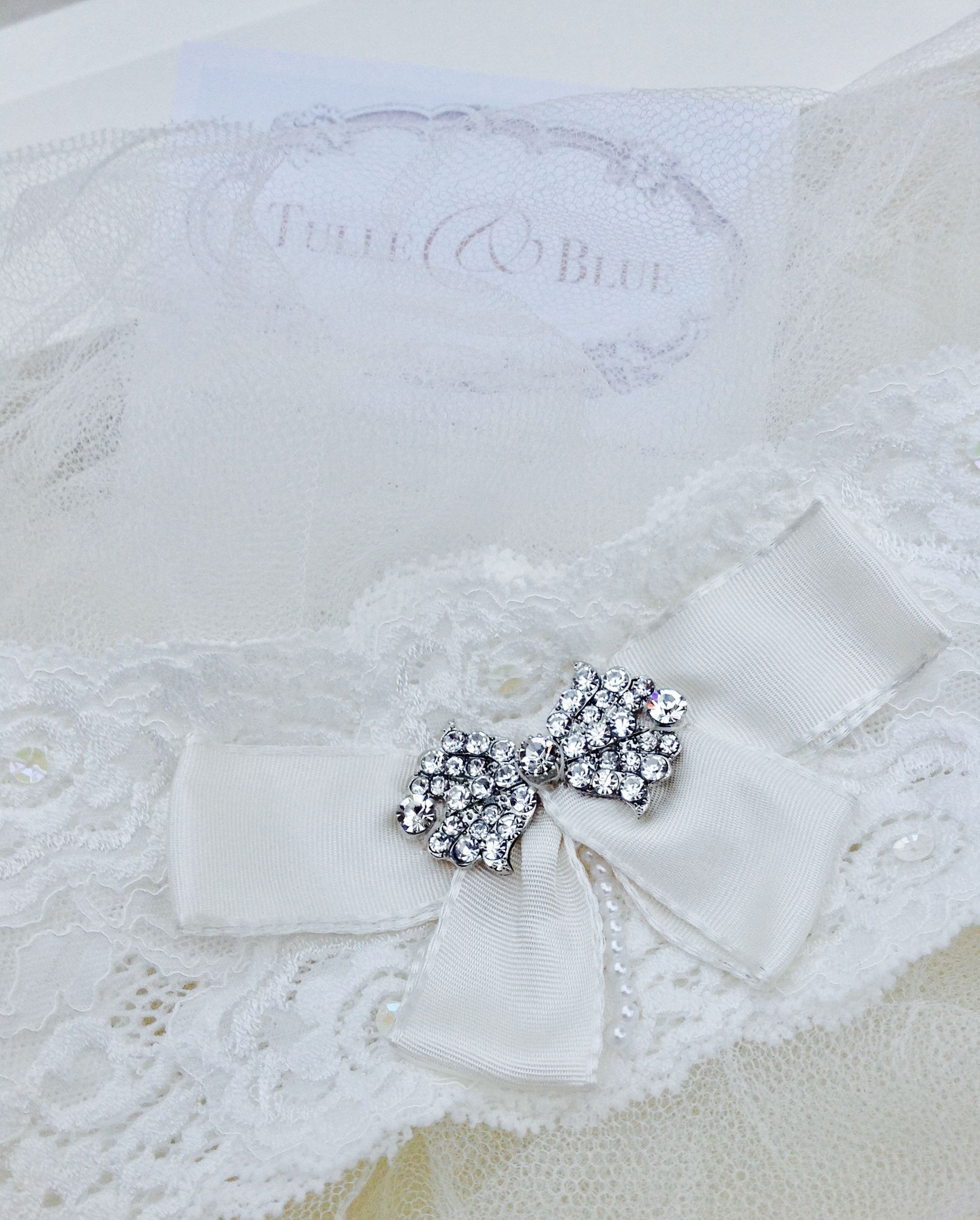 French Lace stretch garter hand finished with a taffeta bow and ...