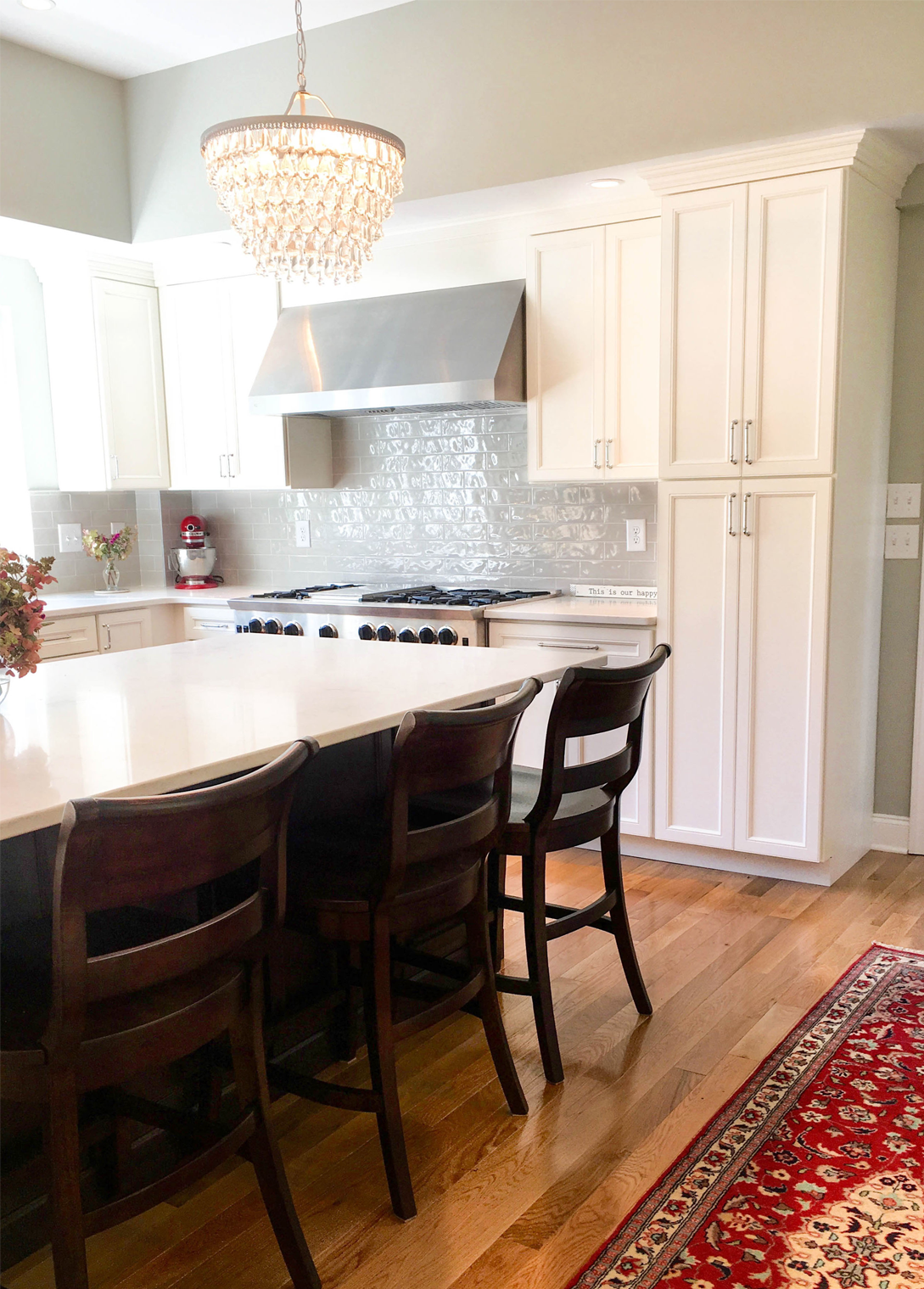 The crystal pendant adds glam to this classic shaker kitchen ...