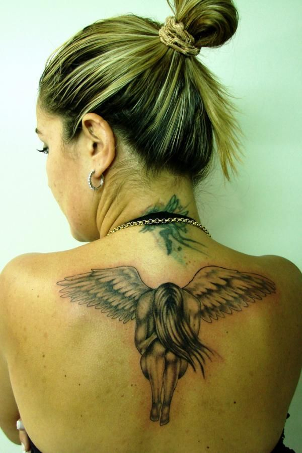 bfd38238c70d2 Angel tattoo meanings, designs and ideas with great images for 2016. Learn  about the story of angel tats and symbolism.