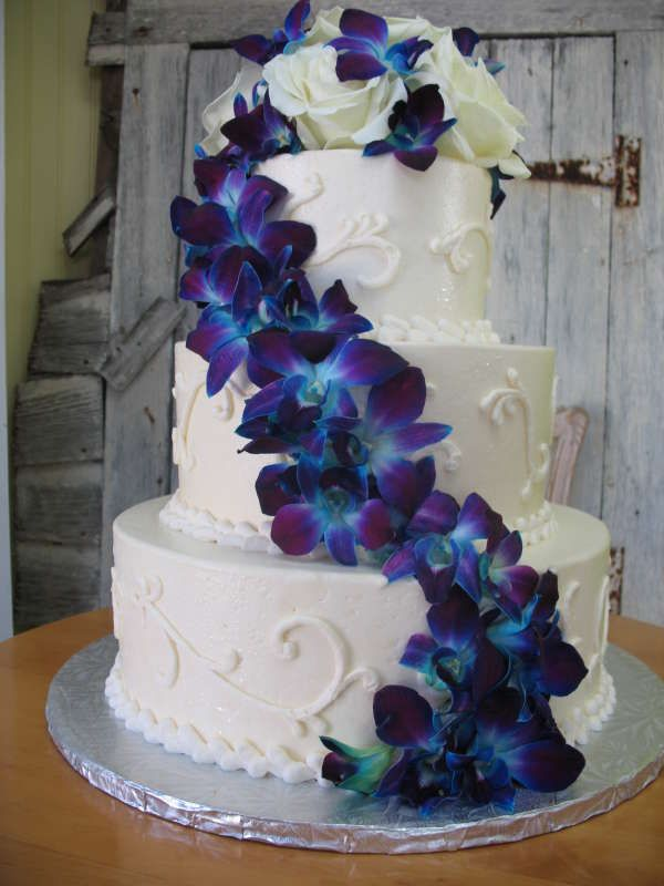 white wedding cake with blue flowers white 3 tier cake with blue flower adornments key west 27403