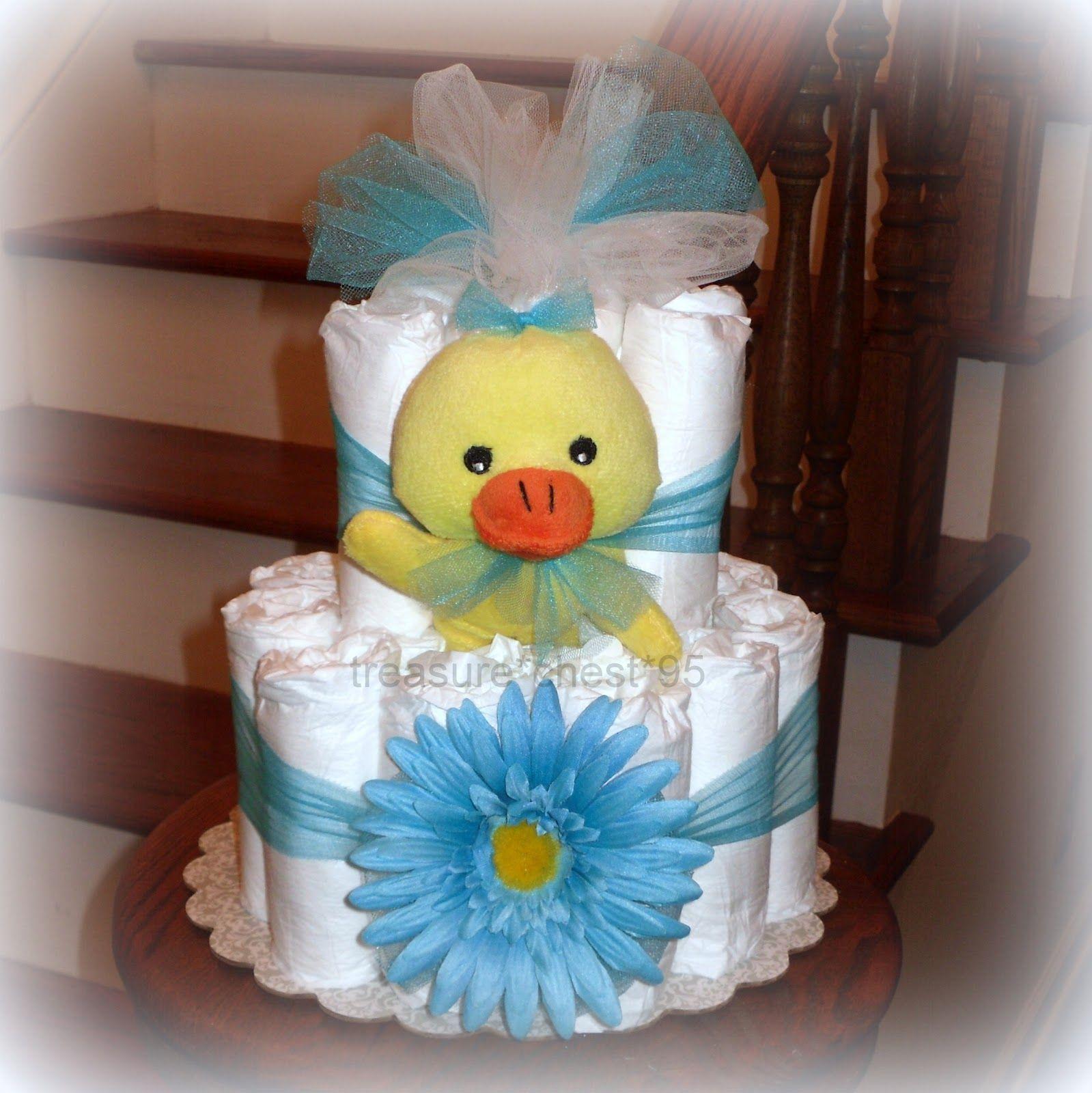 Baby shower centerpiece ideas diaper cake baby shower for Baby diaper cake decoration