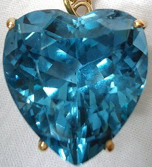 Topaz is a silicate mineral containing aluminum and fluorine. Topaz is usually colorless when pure, but since the mineral can contain any number of chemical impurities, it can also occur in any number of colors.  Usually people associate topaz with a yellowish s