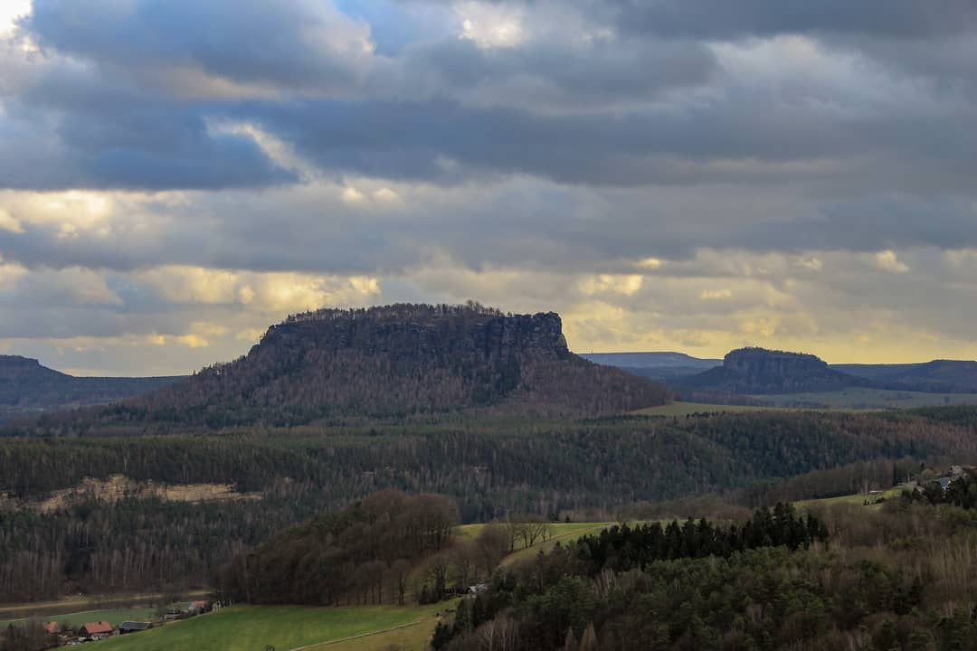 The view of the Lilienstein in between those dramatic clouds was one of my favourite moments from the journey to the #nationalpark #saxonyswitzerland -- Unfortunately, the picture doesn't look as spectacular as in reality, but it's definitely a nice memory! Next time I shouldn't zoom in 🤔😅 -- #lilienstein #saxony #rocks #dramaticsky #niceview #clouds #dramaticclouds #sunset #travelmemories #landscapegoals #naturelover #forest #hikingadventures #aussicht #naturerlebnis #berge #wolken #dramatisc