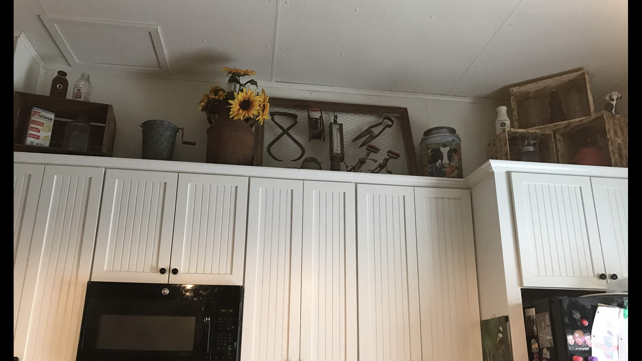 Vintage Decorating above kitchen cabinets. Milk Can, butter churn ...