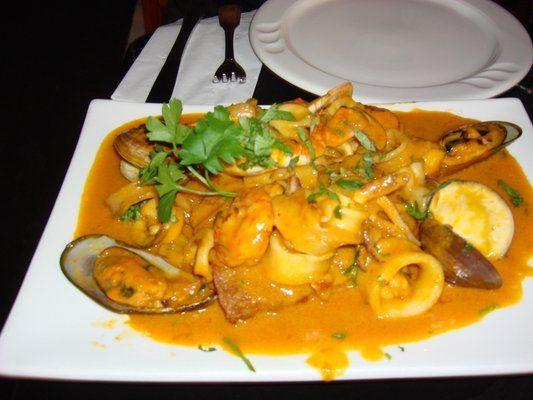 Chimu Pescado A Lo Macho Baked Red Snapper Topped With Seafood Peruvian Recipes Peruvian Dishes Yummy Seafood