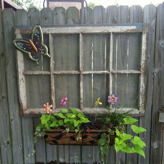Old window we hung on the privacy fence with a window box for Fence ornaments ideas