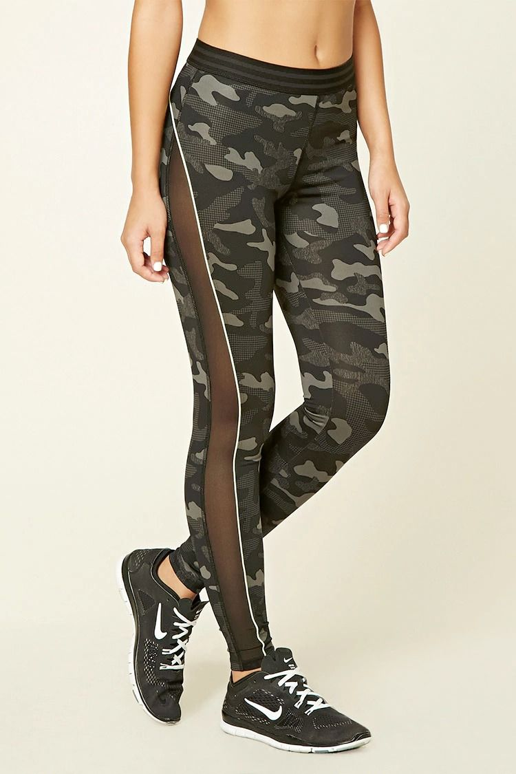 4e71e36ff0bbe A pair of camo print leggings with contrast piping throughout, a striped  waistband, and side mesh inserts.