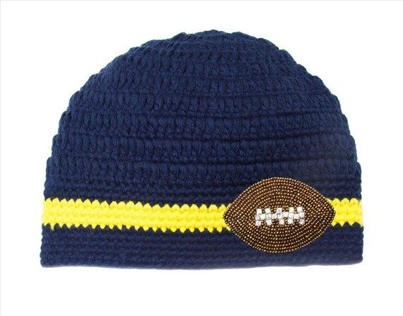 4ae7b2d2929 University of Michigan San Diego Chargers navy blue   yellow (maize) beanie  with a beaded and rhines