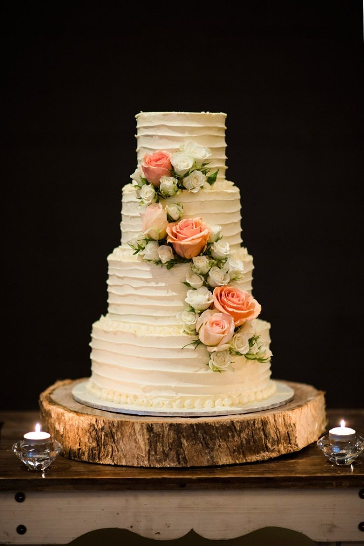 Wedding cakes with cascading roses - peach rose cascading wedding cake #weddingcake