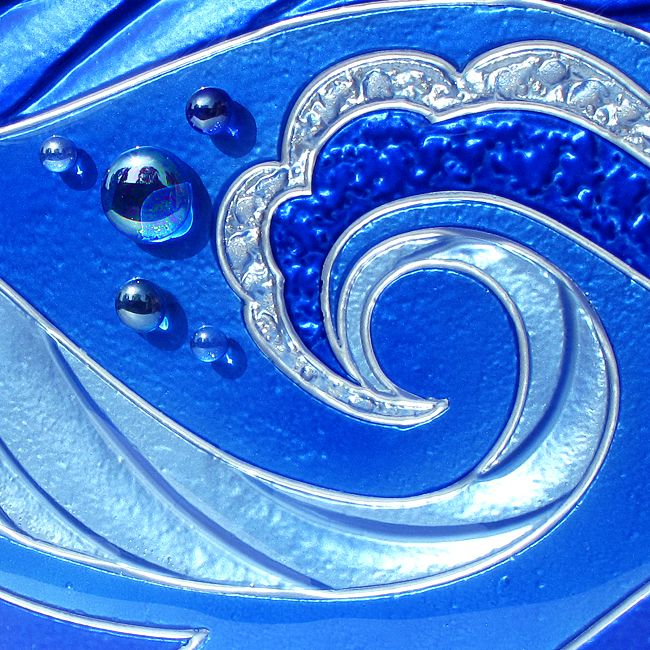 Sample of a custom painted wave design on Low Iron glass.