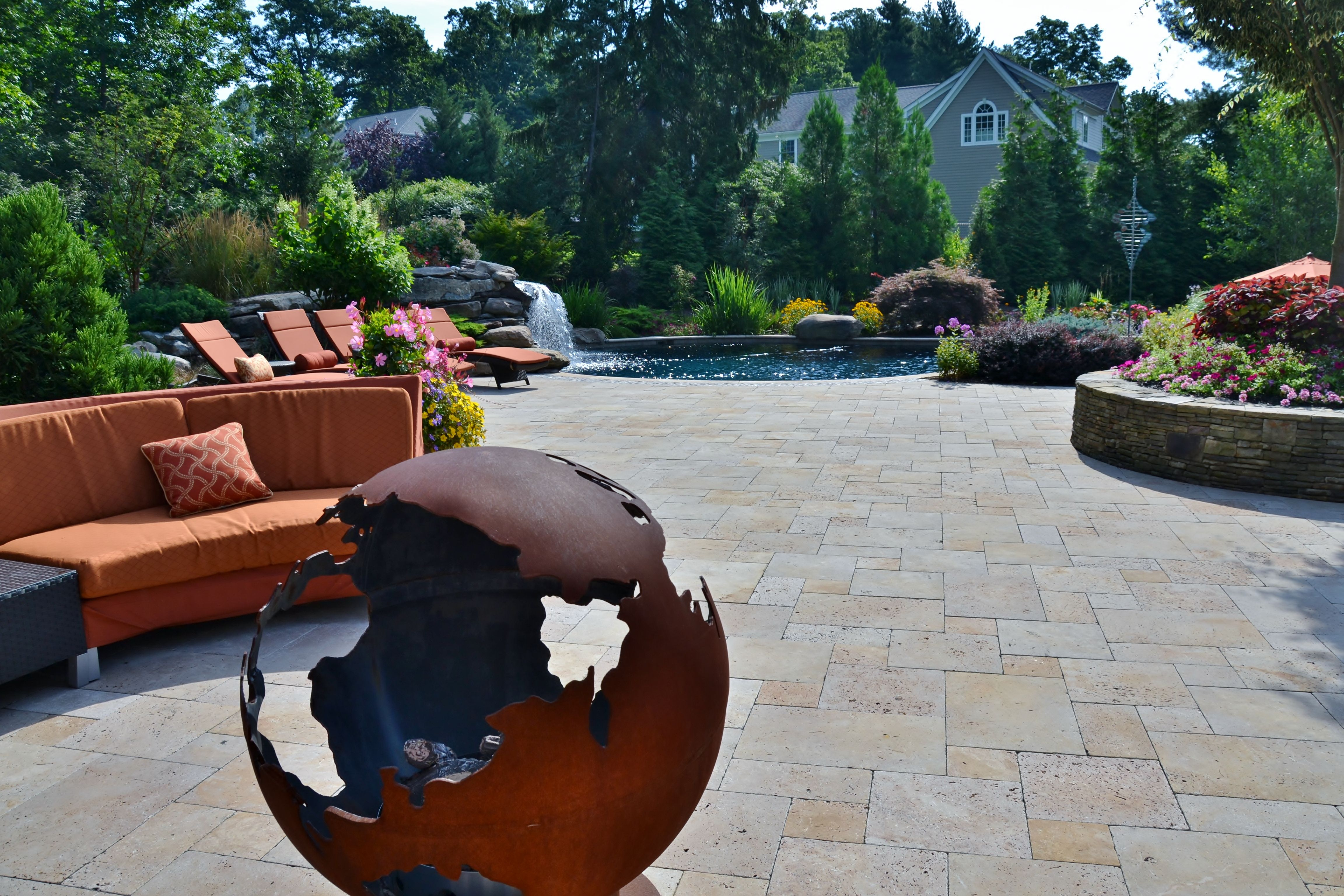 globe fire pit and patio seating resort like swimming pool in nj