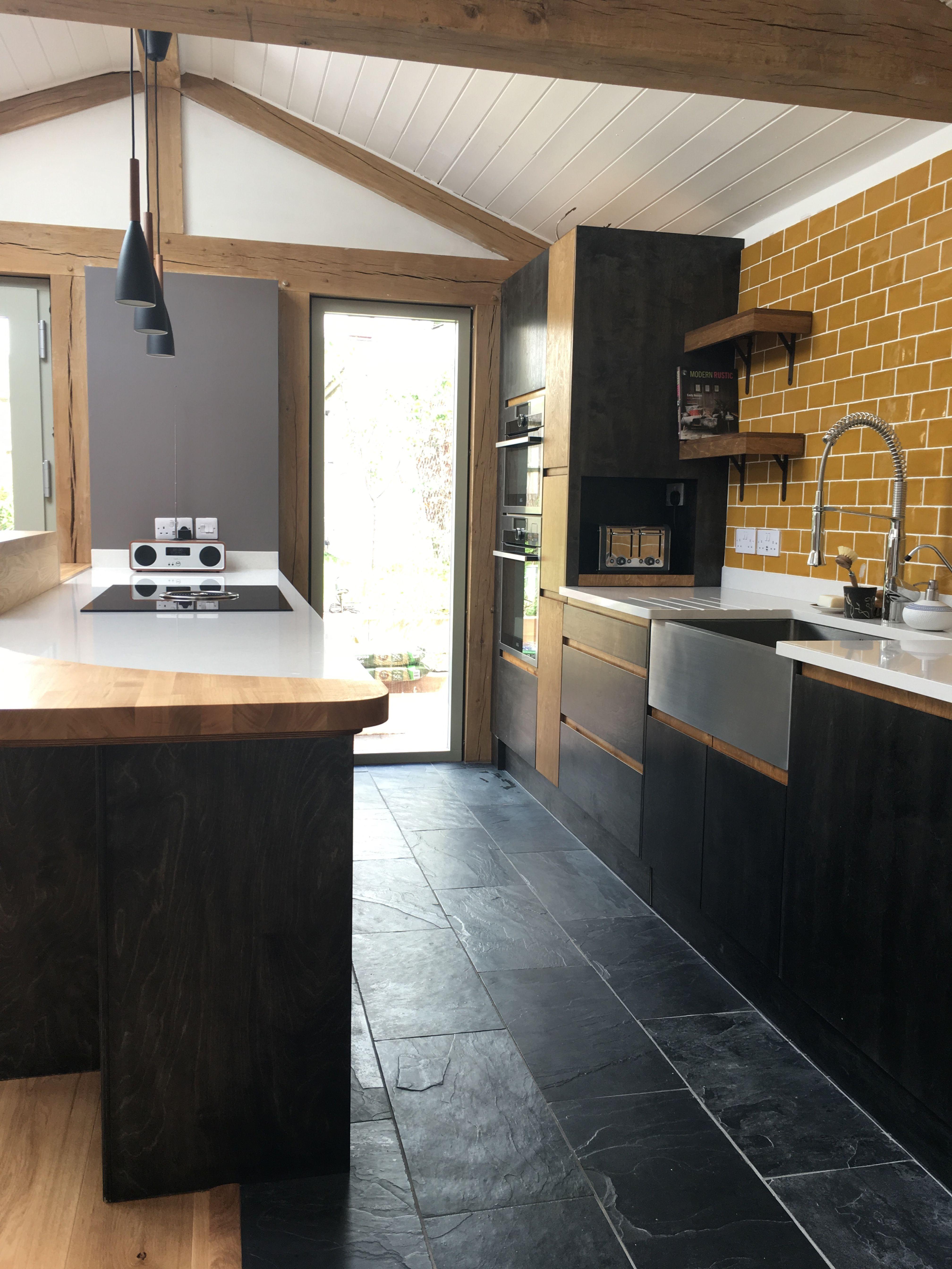 Contemporary kitchen fusing wood and slate   Slate kitchen, Slate ...