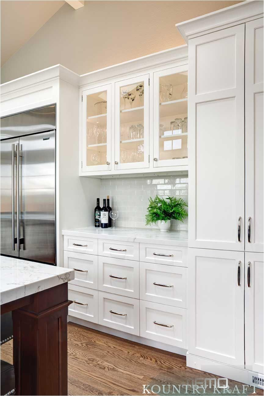 Jun 12 2018 Tall White Kitchen Cabinets Finished In Alpine 45a Finish Designed By Inte In 2020 Glass Kitchen Cabinet Doors Glass Cabinet Doors White Shaker Kitchen