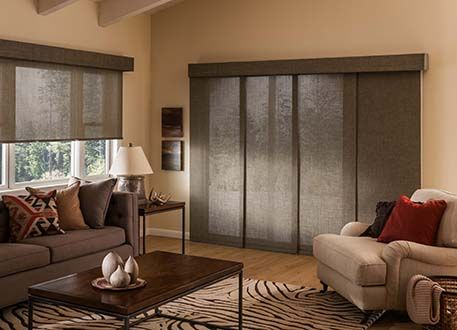 Roller shades can be a new windw treatment idea for sliding glass doors. And the shade color and fabric can match other windows in your home. Call Bellagio Window Fashions for more window treatment ideas.