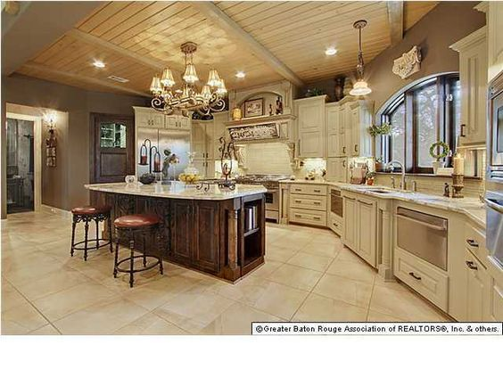 white kitchen cabinet with dark island tan tile floor stainless rh pinterest com