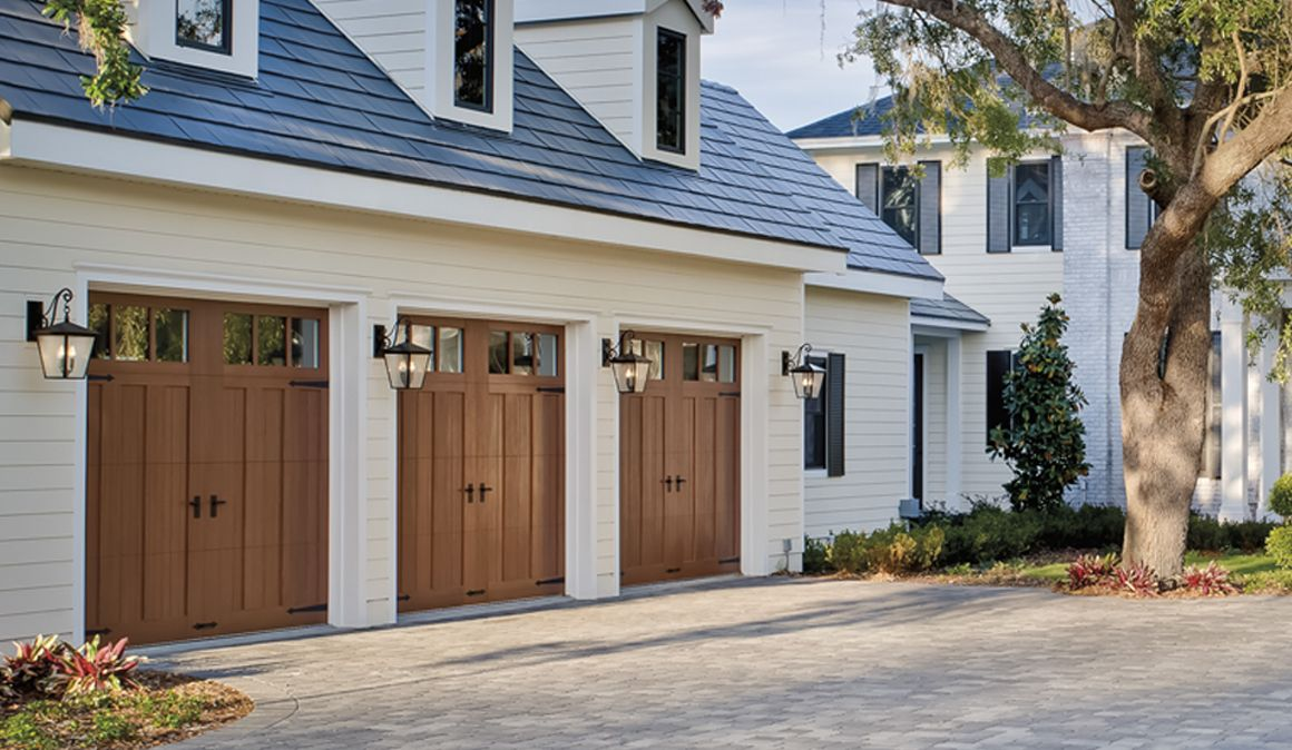 These Garage Doors Are So Pretty You Almost Don T Want To Open Them Faux Wood Garage Door White Exterior Houses Garage Doors