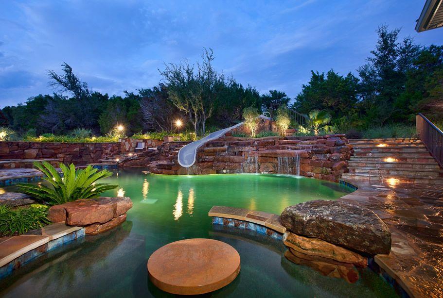 luxury pool slide rock scape ladscape backyard ...