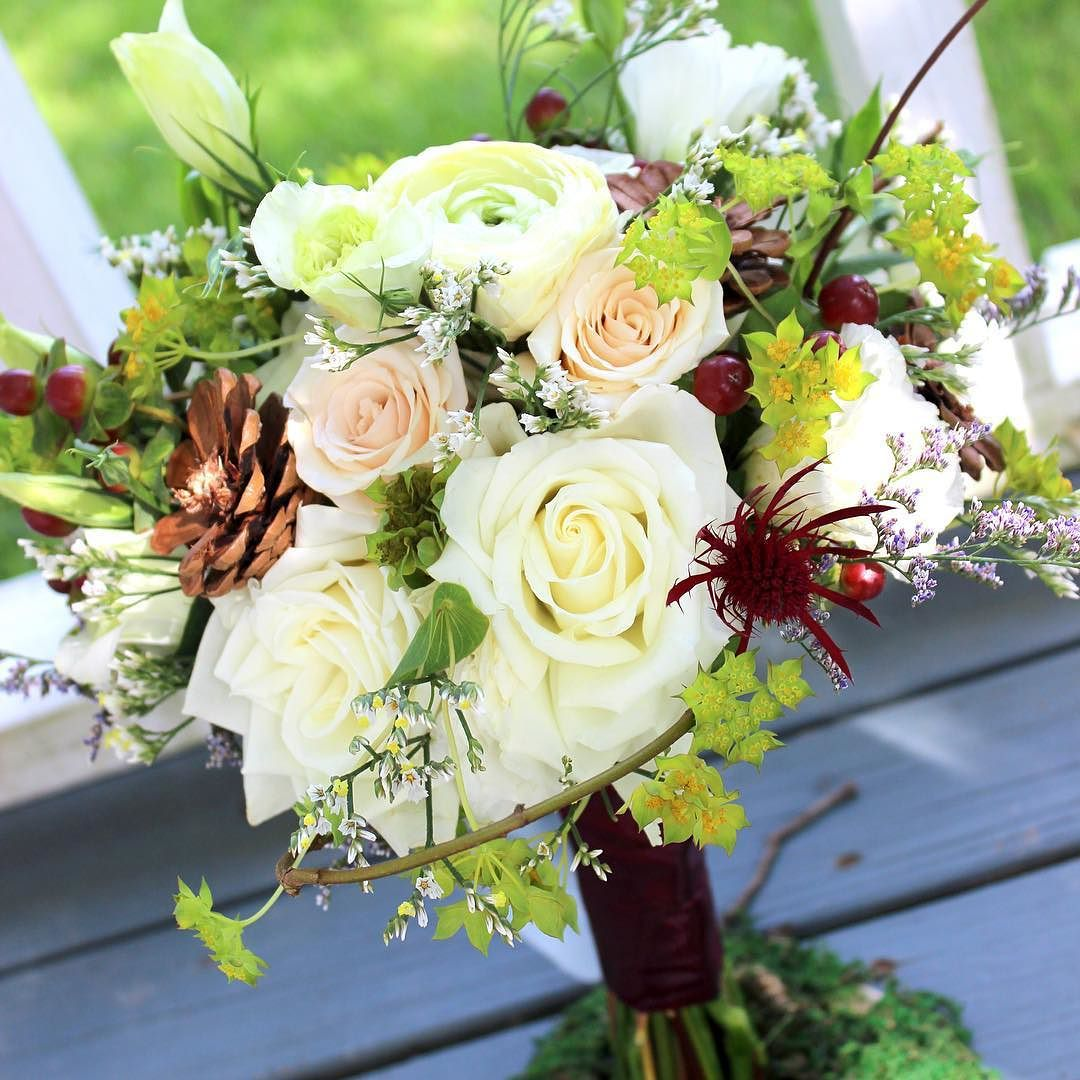 For the bridesmaids shades of ivory and beige roses #pinecone flowers with a touch of burgundy colored #thistle and #bupleurum. Lovely @kelsie_leigh2! #thefloralcottageflorist #julybride #bridesmaid #bridesmaidbouquet #bridesmaidbouquets #bridesmaidsbouquet #bridesmaidsbouquets #fallbouquet #autumnbouquet #fallwedding #autumnwedding #autumnweddings #fallbride #louisianawedding #nolawedding