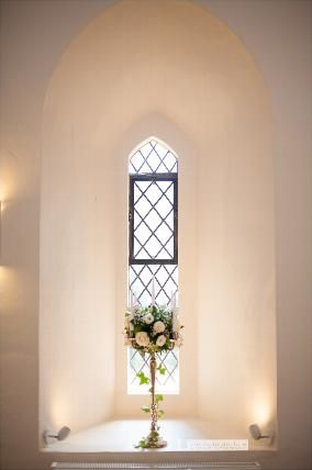 simple and contemporary flower bundle in front of glass panes at farnham castle