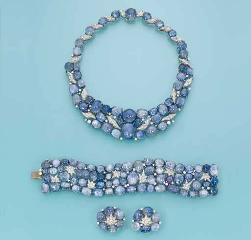 SAPPHIRE AND DIAMOND SUITE, BY VERDURA The necklace of collar form, set with cabochon sapphires interspersed with pavé-set diamond shell motifs, the bracelet and ear clips of similar design with pavé-set diamond stars, circa 1940
