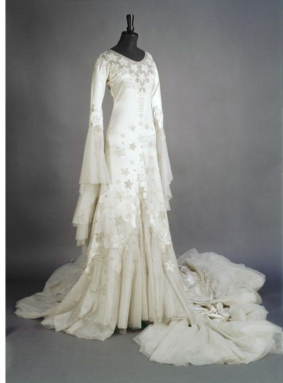 This glorious dress was designed by Norman Hartnell for Margaret Whigham, in 1933.  Her dress was so publicised that crowds turning out to catch a glimpse of it blocked Knightsbridge for three hours!    The whole dress is appliqued with stars outlined in beads, including all around the 12 foot train.  A team of 30 seamstresses worked on the dress for six weeks, and it cost £52 (a year's wage).
