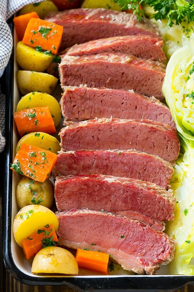 A platter of slow cooker corned beef, cabbage, carrots and potatoes.