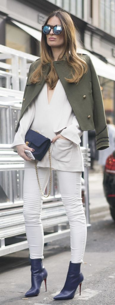 Paris Fashion Week street style: all white paired with blue accessories and a green military coat