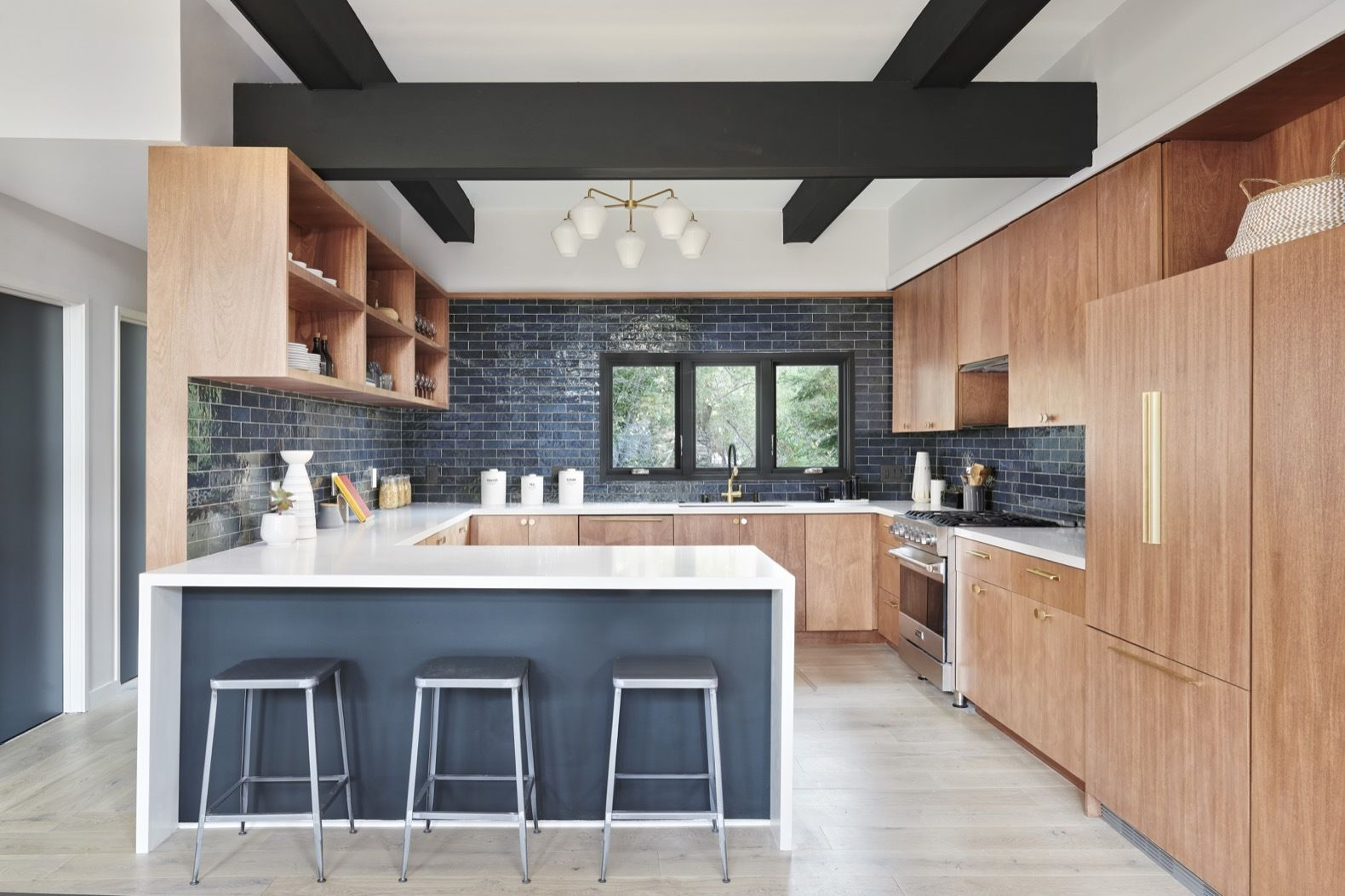 See Arch removed a wall to create a more spacious kitchen with a stronger visual connection to the dining area. The updated kitchen is outfitted with quartz countertops and Viking, Fisher Paykel, and Asko appliances.