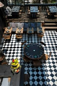 Mexican restaurant with black and white tiled floor and wood chairs.