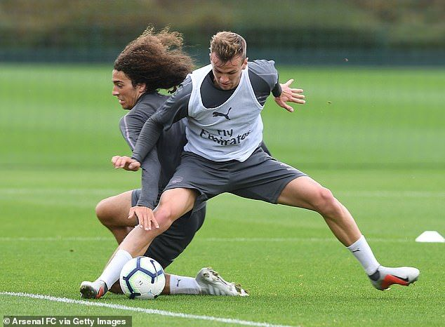 Holding shows his strength as he fends off Guendouzi to take control of the ball
