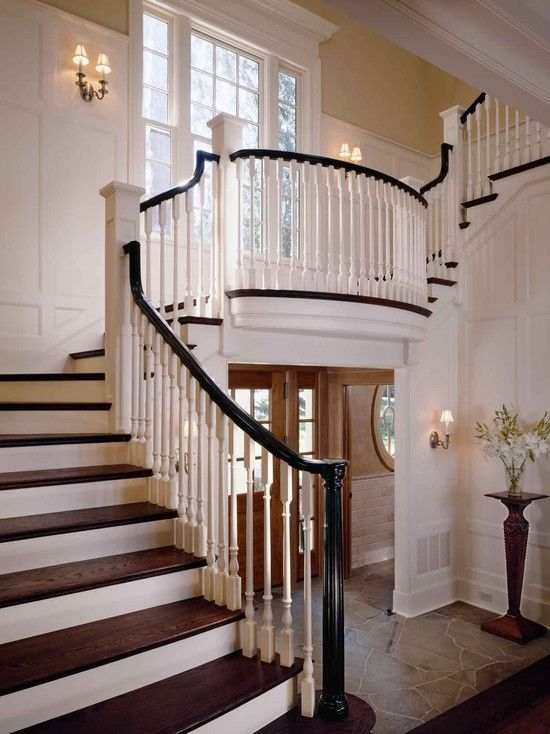 Neat Stairs With Window Traditional Spaces Symmetrical Classic