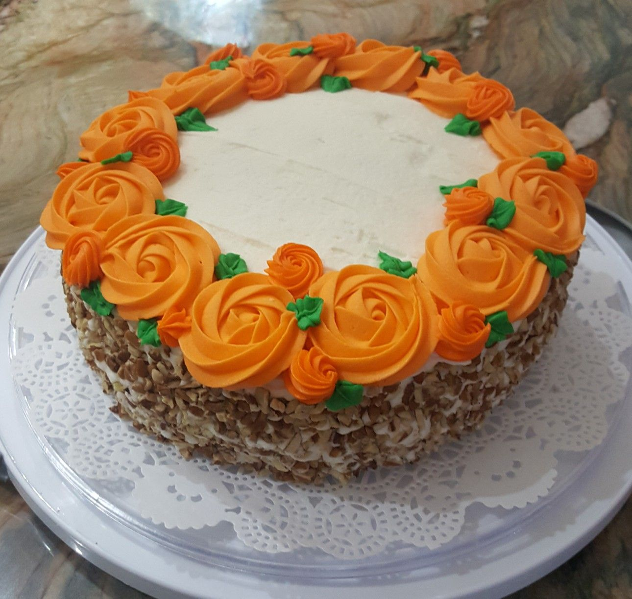 Carrot Cake Decorated With Cream Cheese Icing Orange Rosettes