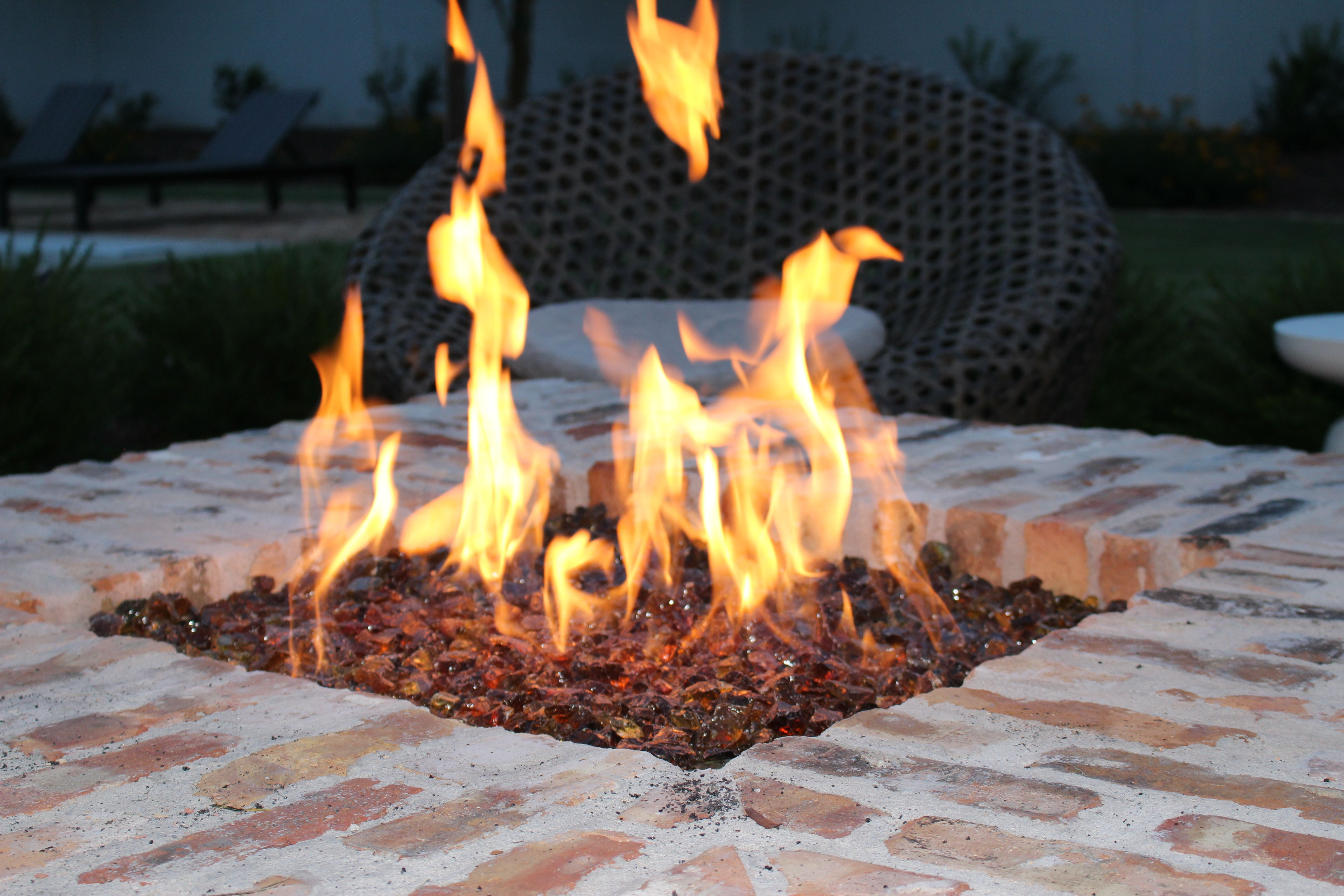 outdoor fireplace using exotic copper reflective fire glass fire