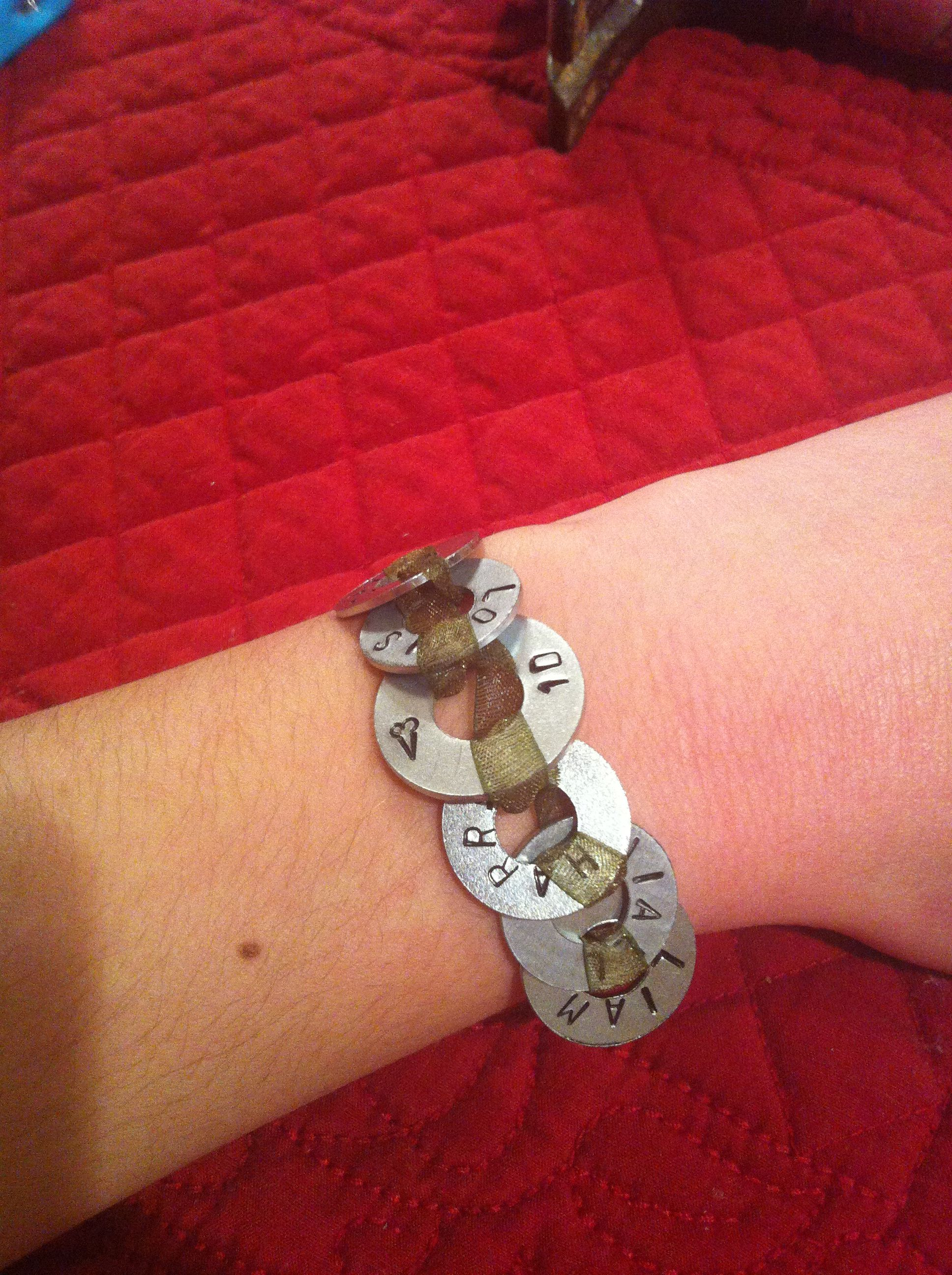 Washer bracelet with metal stamp. This is a one direction one but you could do anything!