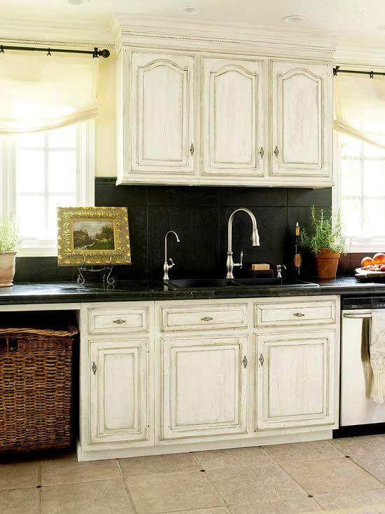 Distresssed Cabinets And Black Travertine Tile Backsplash