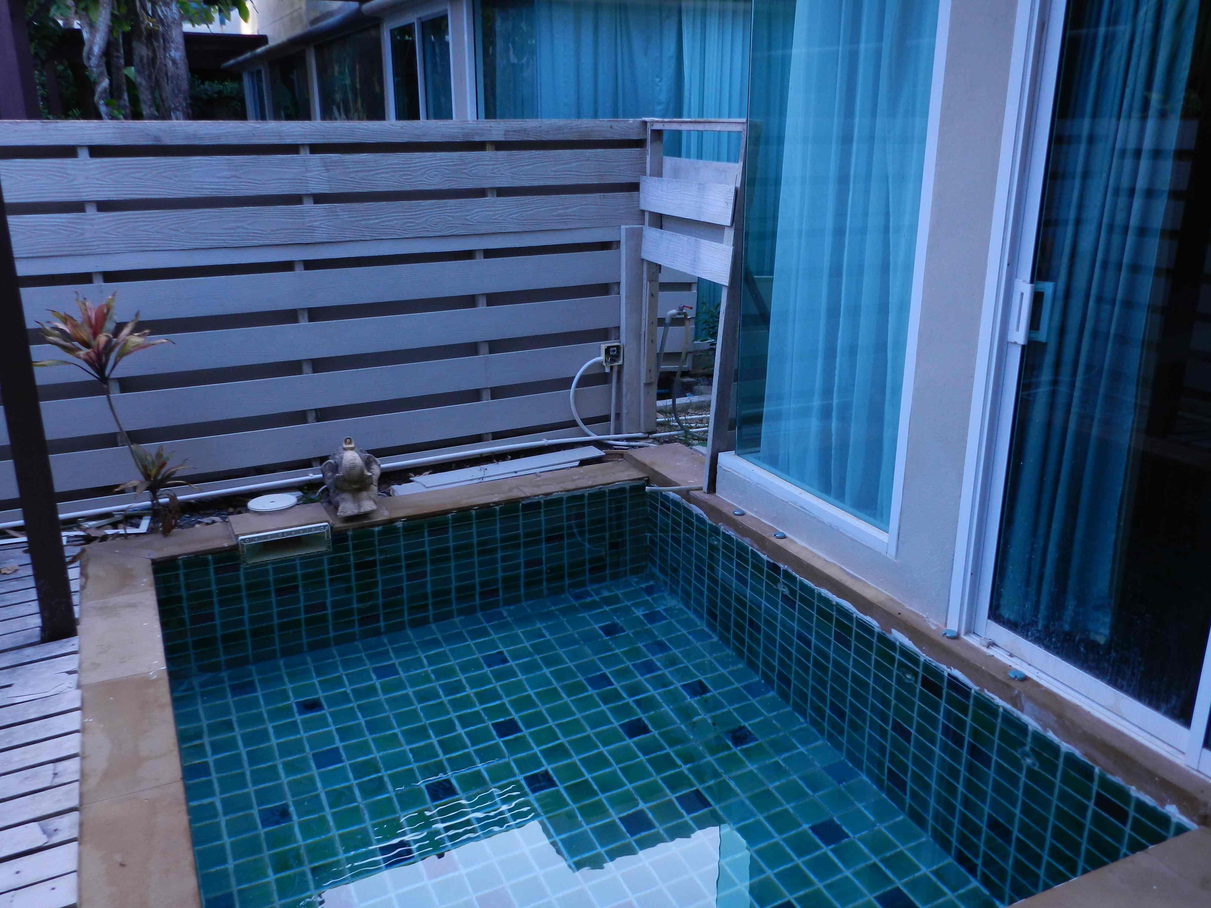 Small Permanent Pool With Square Shaped And Beautiful Checkered Style Tiles Also Wooden Side Above Ground