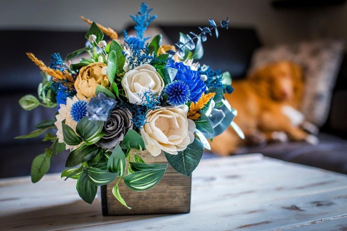 Wood flowers make the perfect centerpiece because they can be dyed any color to match your home and they look so real and require no care! #centerpieceideas #tablecenterpiece #floralcenterpieces #flowercenterpieces #woodflowers #tabledecor #tabledecorations #floraldesigninspiration #tablecenterpiece