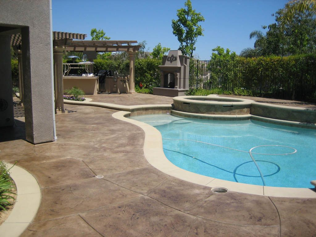 Pool patio deck concrete stamping staining color for Pool design ventura