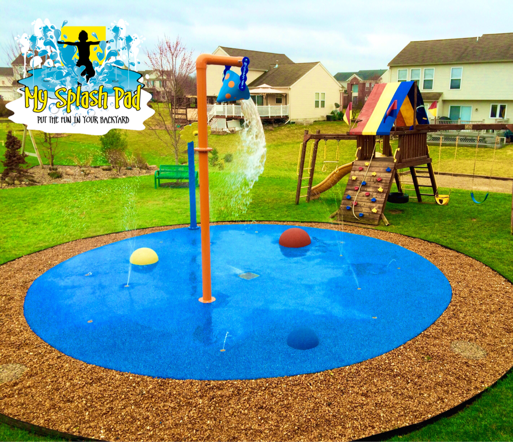residential backyard splash pad with 2 above ground water play